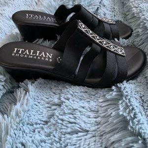 NWOT. Black polyurethane sandals.